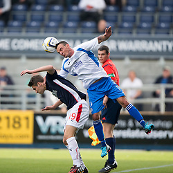 Queen of the South's Derek Lyle over Falkirk's Luke Leahy.<br /> Half time : Falkirk 0 v 0 Queen of the South, Scottish Championship game played today at The Falkirk Stadium.