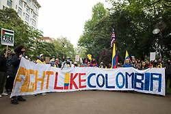 SOS Colombia activists highlighting widespread human rights abuses taking place in Colombia prepare to join an International Bloc for the National Demonstration for Palestine on 22nd May 2021 in London, United Kingdom. The demonstration was organised by pro-Palestinian solidarity groups in protest against Israel's recent attacks on Gaza, its incursions at the Al-Aqsa mosque and its attempts to forcibly displace Palestinian families from the Sheikh Jarrah neighbourhood of East Jerusalem.
