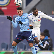 NEW YORK, NEW YORK - March 18: Ronald Matarrita #22 of New York City FC and Chris Duvall #18 of Montreal Impact challenge for the ball during the New York City FC Vs Montreal Impact regular season MLS game at Yankee Stadium on March 18, 2017 in New York City. (Photo by Tim Clayton/Corbis via Getty Images)