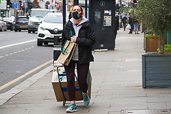 © Licensed to London News Pictures. 20/03/2021. London, UK. A woman wearing a face covering in north London. The UK government fears a rise in Covid-19 cases in the UK amid a new coronavirus surge across Europe, which has led to a number of European countries back into lockdown. Photo credit: Dinendra Haria/LNP