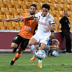 BRISBANE, AUSTRALIA - FEBRUARY 21: Arana of the Roar and Theerathon Bunmathan of Muangthong United compete for the ball during the Asian Champions League Group Stage match between the Brisbane Roar and Muangthong United FC at Suncorp Stadium on February 21, 2017 in Brisbane, Australia. (Photo by Patrick Kearney/Brisbane Roar)