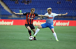 May 26, 2019 - Kharkiv, Ukraine - Defender Bohdan Butko (L) of FC Shakhtar Donetsk and midfielder Vladyslav Vakula of FC Mariupol are seen in action during the Ukrainian Premier League Matchday 31 fixture at the Metalist Stadium Regional Sports Complex, Kharkiv, northeastern Ukraine, May 26, 2019. The Miners have already secured the 2018/2019 UPL title and this year's Ukrainian Cup becoming Ukraine's football club with the most number of trophies. Ukrinform. (Credit Image: © Vyacheslav Madiyevskyy/Ukrinform via ZUMA Wire)
