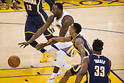 Golden State Warriors forward Draymond Green (23) drives to the basket against the Indiana Pacers at Oracle Arena in Oakland, Calif., on December 5, 2016. (Stan Olszewski/Special to S.F. Examiner)