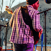 Jason Spooner performs to a packed crowd in Jackson, Wyoming. Portrait - Bassist Adam Frederick.
