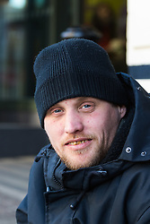 """James, 35, on his pitch outside McDonalds on the High Street opposite Windsor Castle. After a public outcry against their """"homelessness support strategy"""" where rough sleepers would have been fined £100, Windsor council has shelved their plans. Windsor, Berkshire, February 16 2018."""