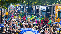 London, August 28 2017. Crowds make their way down Ladbroke grove in a colourful throng on Day Two of the Notting Hill Carnival, Europe's biggest street party held over two days of the August bank holiday weekend, attracting over a million people. © Paul Davey.