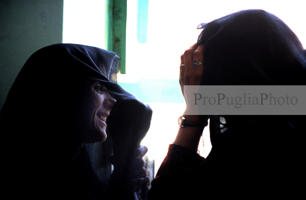 YAFTAL PAYAN, 31 July 2005..Women talking to each other during a Vocational Traning Centre....The VTC aim is to make women aware of their onwn status as Mother and as Woman, by giving lessons on maternity, reproductive health, family planning and post-natal issues.....According to United Nations Population Fund, Afghanistan has among the world?s highest rates of maternal mortality, and Badakhshan has the highest rates ever recorded anywhere in the world, with one mother dying in every 15 births. Underage marriage is one of the primary causes of maternal mortality.....The VTC is funded by UNFPA and implemented by IBNSINA.