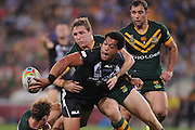 BRISBANE, AUSTRALIA - OCTOBER 25:  Adam Blair of New Zealand offloads the ball in a tackle during the Four Nations Rugby League match between the Australian Kangaroos and New Zealand Kiwis at Suncorp Stadium on October 25, 2014 in Brisbane, Australia.  (Photo by Matt Roberts/Getty Images)