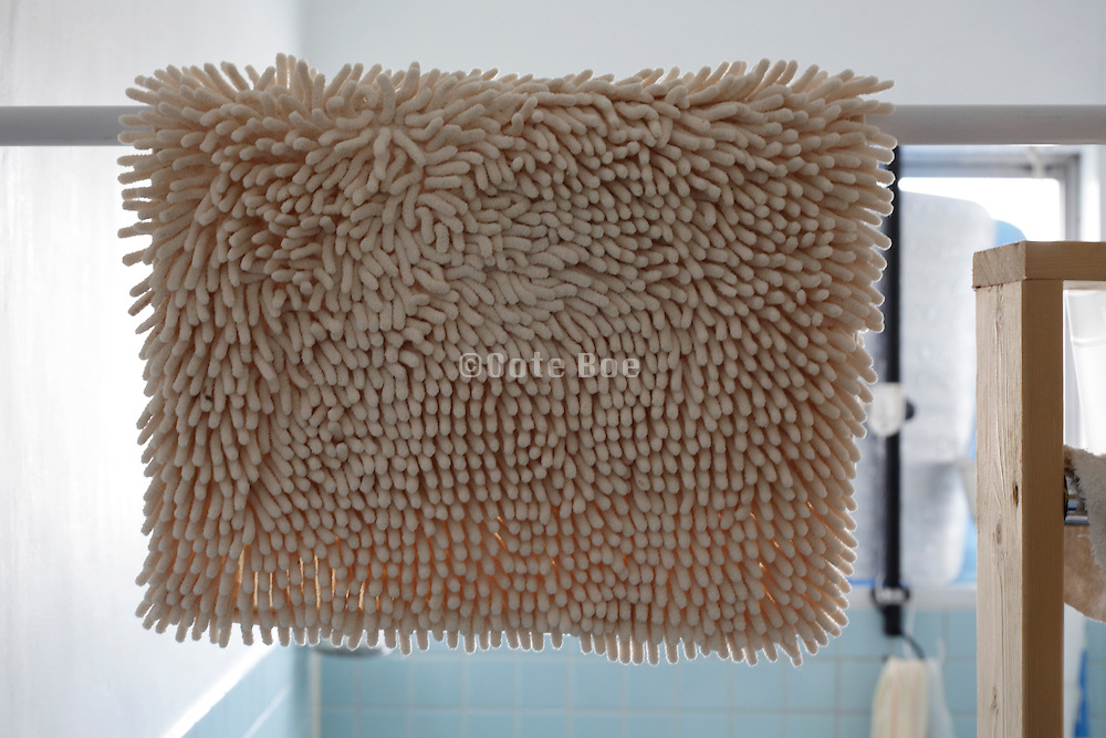 close up of bathroom rug hanging to dry