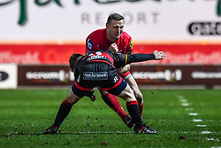 Scarlets' Hadleigh Parkes is tackled by Dragons' Dan Babos<br /> <br /> Photographer Craig Thomas/Replay Images<br /> <br /> Guinness PRO14 Round 13 - Scarlets v Dragons - Friday 5th January 2018 - Parc Y Scarlets - Llanelli<br /> <br /> World Copyright © Replay Images . All rights reserved. info@replayimages.co.uk - http://replayimages.co.uk