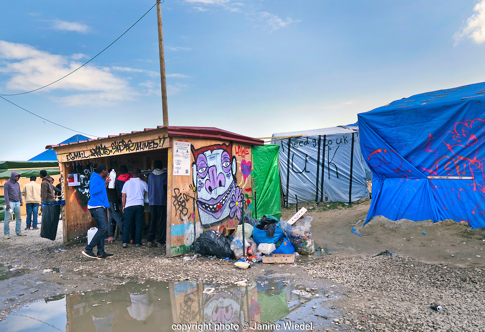 The main section for shops and socialising in The Calais Jungle Refugee and Migrant Camp in France