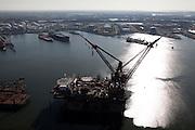 Nederland, Zuid-Holland, Rotterdam, 20-03-2009; Hermod, kraanschip van Heerema Marine Contractors (HMC) in het Calandkanaal. Het werkschip is een zgn. half-afzinkbaar schip waardoor het schip ook onder extreme weersomstandigheden operationeel kan zijn. Het schip heeft een helikopterdek (heliplat) en is voorzien van twee kranen voor gebruik bij constructiewerkzaamheden in de offshore. In de achtergrond de 7e Petroleumhaven. .Hermod, semi submersible crane vessel (SSCV) of Heerema Group. Helicopter Deck heli pad.Swart collectie, luchtfoto (toeslag); Swart Collection, aerial photo (additional fee required).foto Siebe Swart / photo Siebe Swart