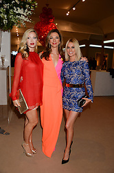 Left to right, CAPRICE BOURRET, HEATHER KERZNER and CAROLINE HABIB at the Masterpiece Midsummer Party in aid of Marie Curie Cancer Care held at The Royal Hospital Chelsea, London on 2nd July 2013.