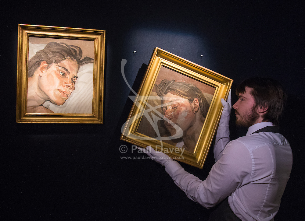 Christies, St James, London, February 5th 2016. A gallery worker hangs Lucian Freud's Head of Ib, next to Head of Esther, a pair of Freud's portraits of his daughters, with each piece expected to fetch up to £3.5 million at auction, in preparation for the 20th Century Art Sale Preview. ///FOR LICENCING CONTACT: paul@pauldaveycreative.co.uk TEL:+44 (0) 7966 016 296 or +44 (0) 20 8969 6875. ©2015 Paul R Davey. All rights reserved.