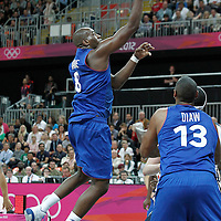29 July 2012: Ali Traore of France goes for the layup during a 98-71 Team USA victory over Team France, during the men's basketball preliminary, at the Basketball Arena, in London, Great Britain.