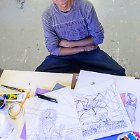 041515  Adron Gardner/Independent<br /> <br /> Tohatchi High School art student Adam Shorty poses for a portrait with samples of his work in art class Wednesday.