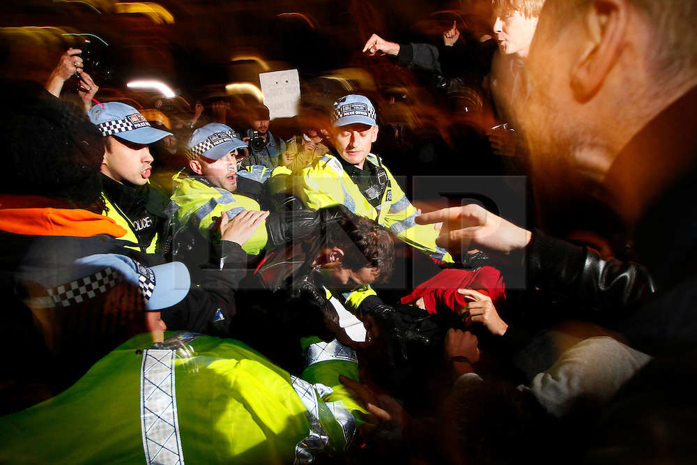 © Licensed to London News Pictures. 15/10/2011. LONDON, UK. Police clash with protesters on the steps of St Pauls cathedral.  Protesters had occupied the churchyard when Police officers attempted to clear the steps of St Pauls'.  Protesters attempted to occupy the London Stock Exchange today (Saturday) in solidarity with protests in New York's financial district. Photo credit : James Gourley/LNP