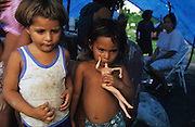 Central America, Honduras, Tegucigalpa, Aguan Valley, Choluteca, Roatan Islands. Devastation in the aftermath of Hurricane Mitch. High winds and flooding. Refugee camp. Traumatized children with doll. Infrastructure destroyed