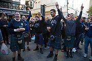 Scotland fans in joyous mood drinking and singing together in Covent Garden ahead of their football match, England vs Scotland, World Cup Qualifiers Group stage on 11th November 2016 in London, United Kingdom. The Home International rivalry between their respective national teams is the oldest international fixture in the world, first played in 1872.