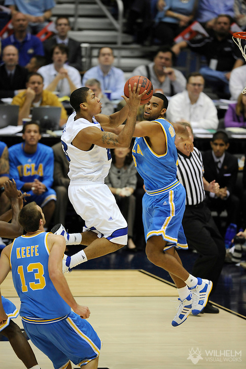 5 APR 2008: Josh Shipp (3) of the University of California - Los Angeles  tries to block the shot of  Derrick Rose (23) of the University of Memphis clash during semifinal game of the 2008 NCAA Final Four Division I Men's Basketball championships held at the Alamodome in San Antonio, TX.  Kansas defeated Memphis 75-68 to advance to the championship game.  © Brett Wilhelm