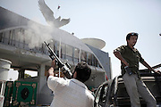 Sco0033837 .  Daily Telegraph..Rebel fighters outside the Headquarters of Khamis Gaddifi's elite Special Forces Brigade in southern Tripoli..Tripoli 28 August 2011. ............Not Getty.Not Reuters.Not AP.Not Reuters.Not PA