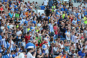 Brighton fans celebrate their team winning the Pre-Season Friendly match between Brighton and Hove Albion and Sevilla at the American Express Community Stadium, Brighton and Hove, England on 2 August 2015. Photo by Ellie Hoad.