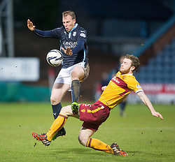 Dundee's David Clarkson and Motherwell's Mark O'Brien . <br /> Dundee 4 v 1 Motherwell, SPFL Premiership played 10/1/2015 at Dundee's home ground Dens Park.