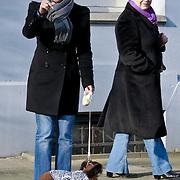 NLD/Amsterdam/20110302 - Tatjana Simic met hond aan het winkelen in een hondenjasje van Addy van den Krommenacker