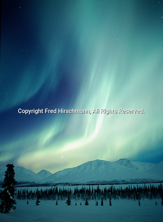 Aurora above the Talkeetna Mountains viewed from Broad Pass during geomagnetic storm on January 17, 2005, Alaska.