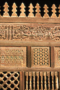Egypt, 2000 - A wooden door hand carved with traditional Islamic decorations. The door partitions off a section of a mosque in old Islamic Cairo.