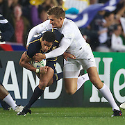 Joe Ansbro, Scotland, is tackled by Toby Flood, England, during the England V Scotland Pool B match during the IRB Rugby World Cup tournament. Eden Park, Auckland, New Zealand, 1st October 2011. Photo Tim Clayton...