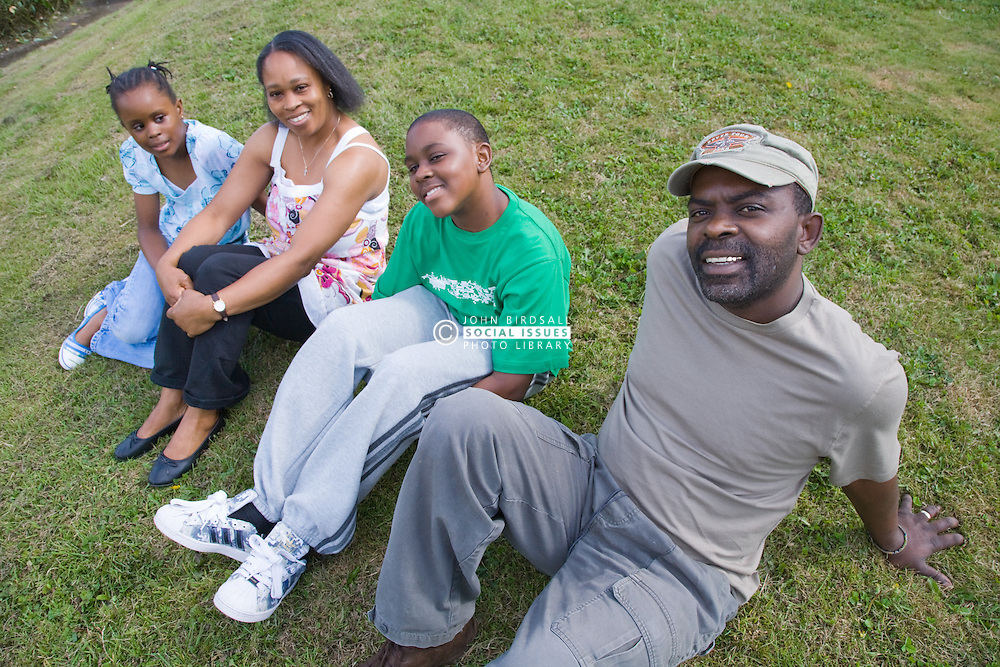 Family sitting together on the grass,