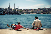 A Turkish father plays with his son on the Bosphorus coast in Kadikoy district in Istanbul, Turkey, June 16, 2009.<br /> <br /> This image is part of the series 'Bos-for-Us: Daily life on Istanbul Bosphorus'.<br /> <br /> © Giorgio Perottino