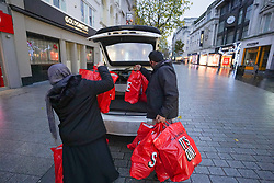 © Licensed to London News Pictures. 26/12/2019. Liverpool, UK. Shoppers load their shopping at the boot of their card during the Boxing Day sales in central Liverpool.   Photo credit: Ioannis Alexopoulos/LNP