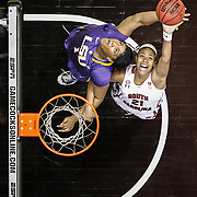 South Carolina Gamecocks women's college basketball player Ashley Bruner pulls in a rebound against LSU in 2013. The event was the last basketball game played at The Carollina Coliseum. ©Travis Bell Photography
