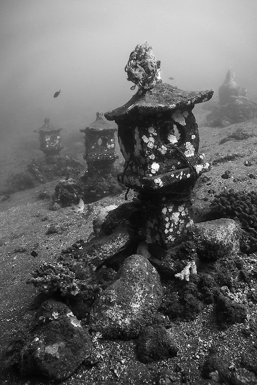 INDONESIA. Tulamben, Bali. June 19th, 2013.  Sunken stupas rest at around 15-meters in Bali's Coral Gardens dive site. These reliefs were sunk as part of an artificial reef program to enhance the health of the local reefs and surrounding area.