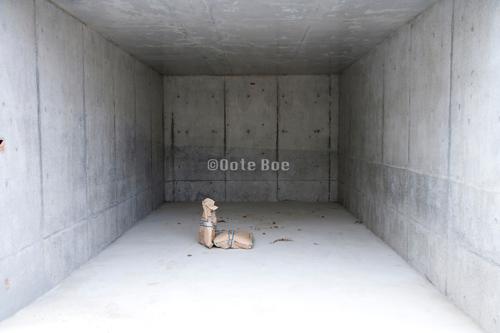 cement sacks inside a new concrete walled space