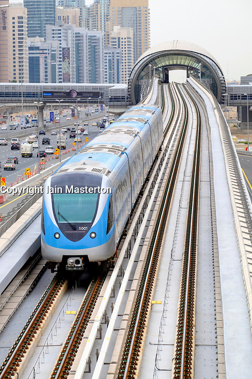 View of Dubai metro train on viaduct in Dubai United Arab Emirates