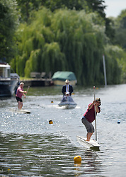 """© Licensed to London News Pictures. 11/08/2013. Action from the annual """"Thames Punting Club Regatta""""  on the River Thames at Bray Reach, Maidenhead, Berkshire, UK. Now in it's 128th year it is considered The World Championship as it is the only punting  Regatta in The World. There are various categories such as Gentlemen's Double, Mixed Double, Ladies, Gentlemen & Junior Championships.  Photo credit:  Mike King/LNP"""