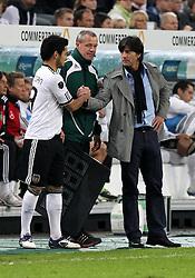 11.10.2011, Esprit Arena, Duesseldorf, GER, UEFA EURO 2012 Qualifikation, Deutschland (GER) vs Belgien (BEL), im Bild...Bundestrainer Joachim Löw und Ilkay Gündogan (beide GER) vor der Einwechslung ..// during the UEFA Euro 2012 qualifying round Germany vs Belgium  at Esprit Arena, Duesseldorf 2011-10-11 EXPA Pictures © 2011, PhotoCredit: EXPA/ nph/  Hessland       ****** out of GER / CRO  / BEL ******
