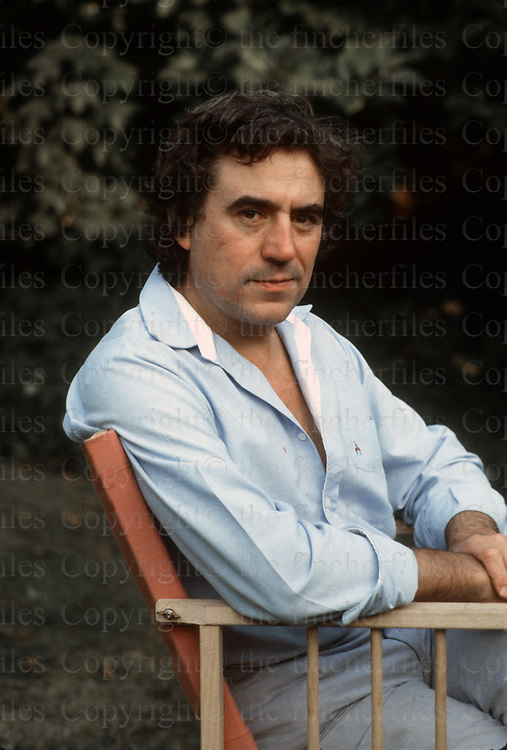British comedian Terry Jones from Monty Python fame seen in his garden at his London home in August 1983. Photograph by Jayne Fincher