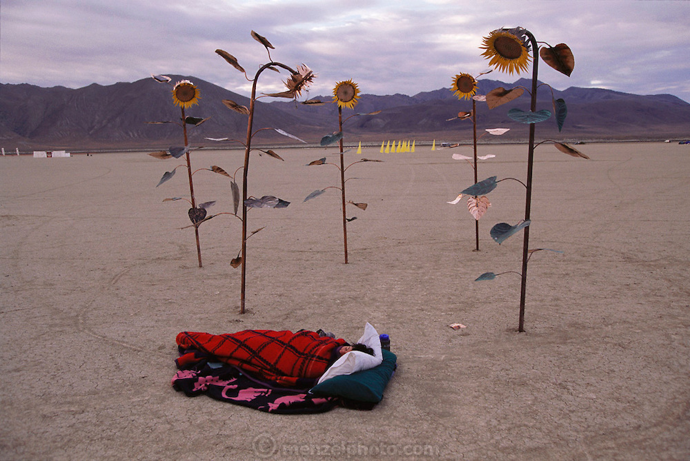 An artist sleeps near her art installation at Burning Man. Burning Man is a performance art festival known for art, drugs and sex. It takes place annually in the Black Rock Desert near Gerlach, Nevada, USA.