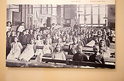 Wooden desks in school classroom from early 1900s, Radstock museum, Somerset, England, UK old monochrome photograph 1908
