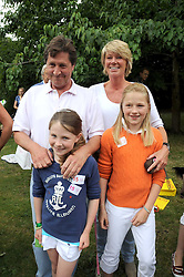 SIMON & KATE SLATER with their daughters left to right, ROSE SLATER and FLORA SLATER at the Macmillan Dog Day in aid of Macmillan Cancer Support held at the Royal Hospital Chelsea, London on 8th July 2008.<br />