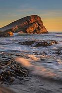 Sunset at Greyhound Rock, a tombolo sea stack, Greyhound Rock County Park, Santa Cruz County coast, California