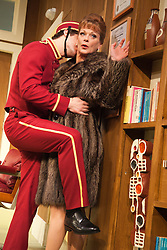 © Licensed to London News Pictures. 09/05/2012. London, England. Nick Hendrix as Nicholas Beckett and Samantha Bond as Mrs Prentice. What the Butler Saw by Joe Orton and directed by Sean Foley opens at the Vaudeville Theatre, London. Photo credit: Bettina Strenske/LNP