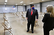 Illinois Governor J.B. Pritzker listens to Myla Blandford, deputy director of the St. Clair County Health Department, as she takes him on a tour of the mass vaccination site at the Belle-Clair Fairgrounds in Belleville, IL on February 18, 2021.<br /> Photo by Tim Vizer