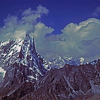 Afternoon clouds billow around a Himalayan peak in Nepal's Khumbu region, near Mount Everest. (Cholatse?)