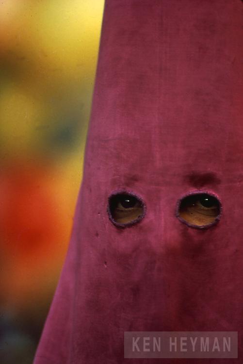 Hooded man, Semana Santa in Seville, Spain