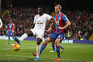 Bafetimbi Gomis of Swansea City in action. Barclays Premier League match, Crystal Palace v Swansea city at Selhurst Park in London on Monday 28th December 2015.<br /> pic by John Patrick Fletcher, Andrew Orchard sports photography.